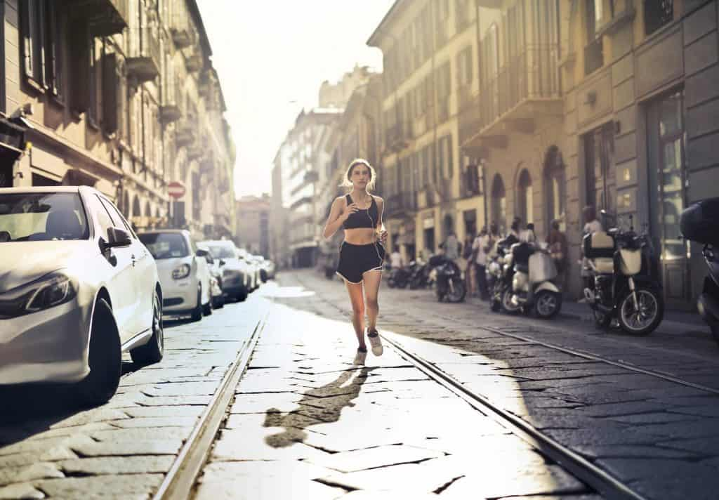 woman running on street